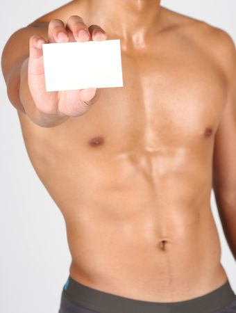 man holding a white card in his hand photo