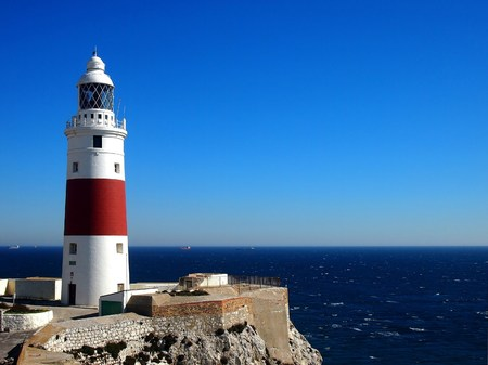gibraltar: Trinity Lighthouse at Europa Point, marking the meeting point of the Mediterranean Sea and the Atlantic Ocean, in Gibraltar Stock Photo