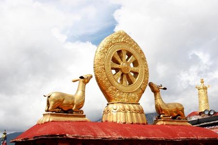 dharma: Gilt wheel of the dharma and two deer at Jokhang Monastery in Lhasa, Tibet Stock Photo