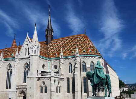double cross: Exterior of Matthias Church, with the statue of King Stephen in the foreground, Budapest, Hungary Stock Photo