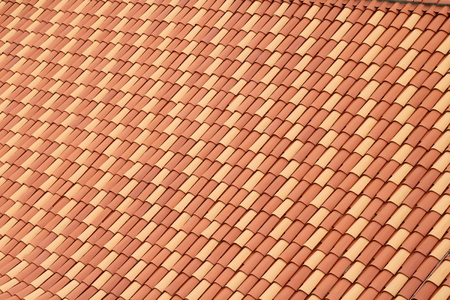 rooftile: Rooftiles laid uniformly with regular patterns of yellow and orange colored tiles