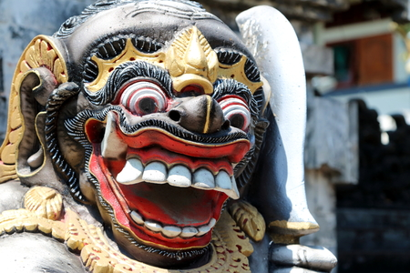 Details of the face of a Balinese statue of a guardian god