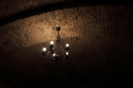 Vintage chandelier at the ceiling of a cellar Stock Photo