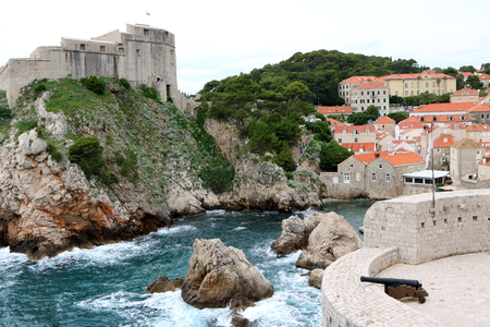 Dubrovnik old town with Bokar Tower in the foreground, and St Lawrence Fortress in the background, Croatia