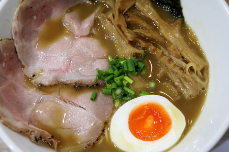 Japanese ramen in Kyoto, with pork, bamboo shoot, and hot spring egg in hot broth