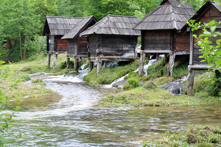Wooden huts housing the traditional watermills at Pliva Lake, Bosnia and Herzegovina