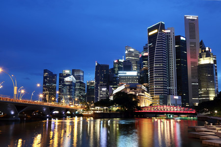 Singapores financial district at night around the mouth of Singapore River