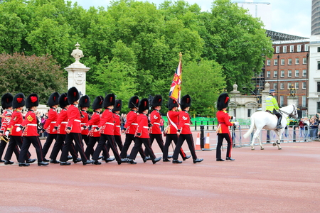 London, United Kingdom - 19 May 2017:  Ceremonial guards marching pass the Mall towards Buckingham Palace for the change of guards ceremony Editorial