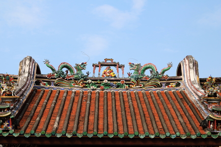 Traditional Teochew (Chaozhou) Architecture in Penang, with dragons and pheonix formed by small pieces of ceramics, with fire separation wall on both sides