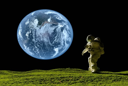 space flight: Astronaut on the grass against the sky Stock Photo