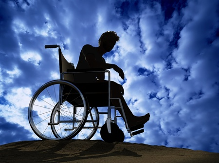 impairment: Silhouette of man on a wheelchair Stock Photo