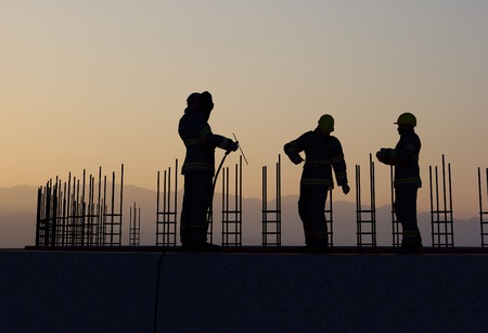 hard working people: Work on the construction at night       Stock Photo