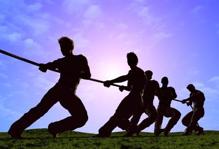 Siluetas de personas tirando de la cuerda. Foto de archivo - 20118801