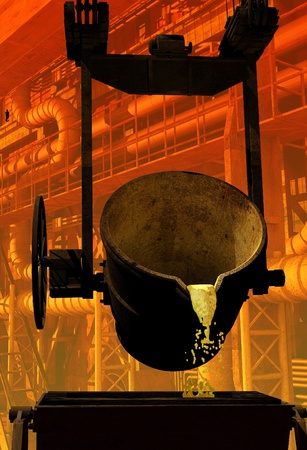 metallurgy: Metal Casting on the background of the interior of the plant.