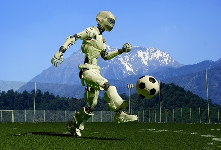 A mechanical robot ran on the green grass. photo