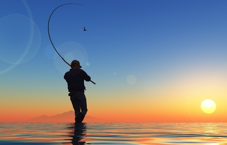 silueta masculina: Silueta del pescador en la puesta del sol. Foto de archivo