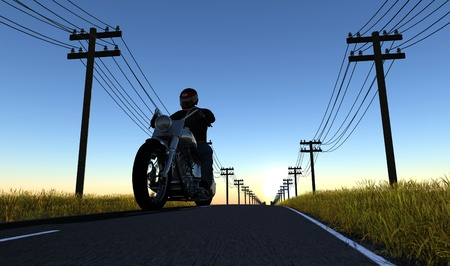 Biker on the road against the sky photo