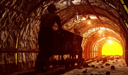 steel workers: Workers pushing the cart in the mine. Stock Photo