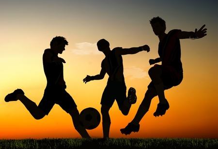 Silhouettes of soccer players. photo