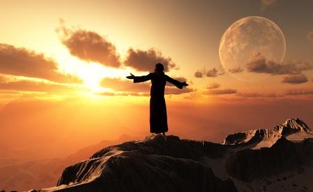 Een silhouet van een priester in een landschap. Stockfoto