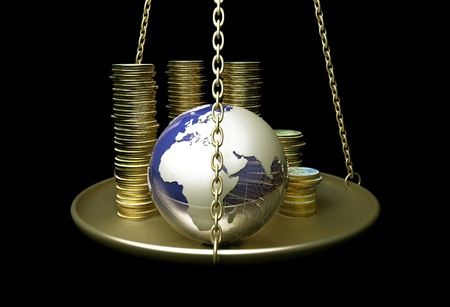 economy: Globe and coins on scales.