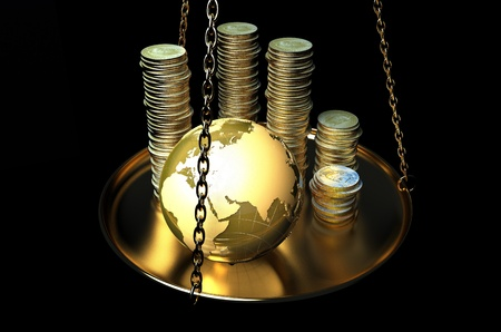 education loan: Globe and coins on scales.