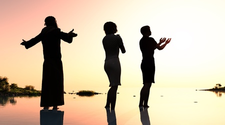 doomsday: Silhouettes of people are praying people. Stock Photo