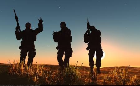 battle tank: A group of soldiers against the dawn. Stock Photo