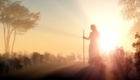 Silhouet van Jezus in het zonlicht Stockfoto