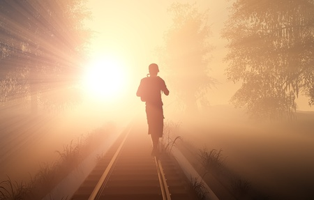 Silhouette of a man on the railroad. photo