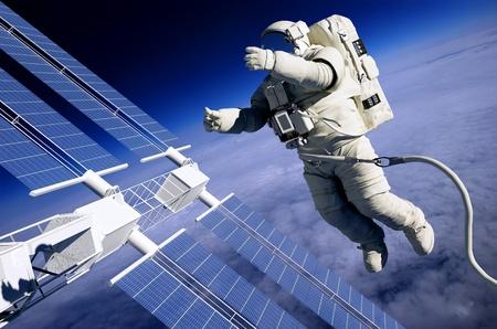 Astronauts in space around the solar battarei. Stock Photo