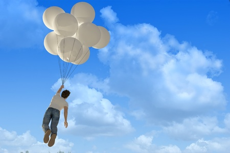 releasing: Man flies on the balloons in the sky. Stock Photo