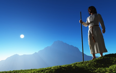 Jesus is in the background of a mountain landscape. photo