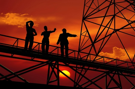 chemical engineering: Silhouette of worker at the plant. Stock Photo