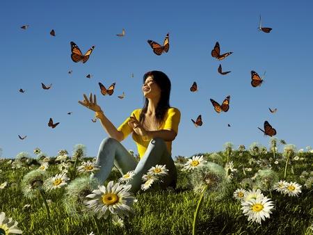 donna farfalla: Una ragazza ed una farfalla sul prato. Archivio Fotografico