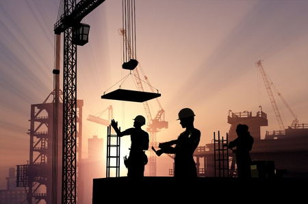 building plans: Silhouette of a worker on a background sky
