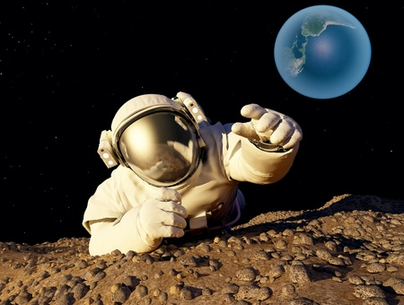 Astronaut crawling on the planet. photo