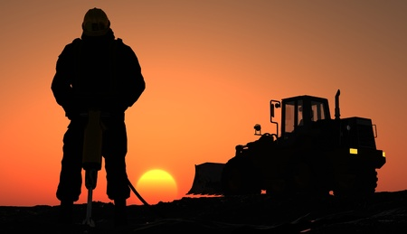 coal mining: Silhouette of the worker and tractor.