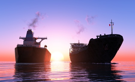 Two cargo ship at sunset. Imagens