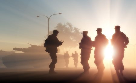 military silhouettes: A group of soldiers against the dawn. Stock Photo