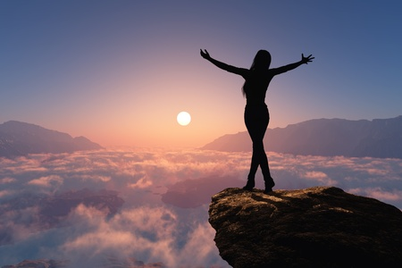 climbing mountain: Silhouette of a woman on a rock. Stock Photo