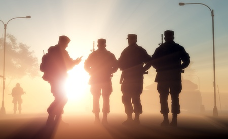 soldier silhouette: A group of soldiers against the dawn. Stock Photo