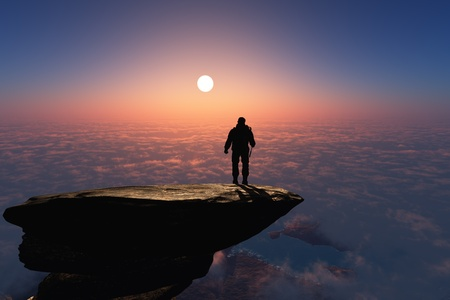 climbing mountain: Silhouette of a man on a rock. Stock Photo