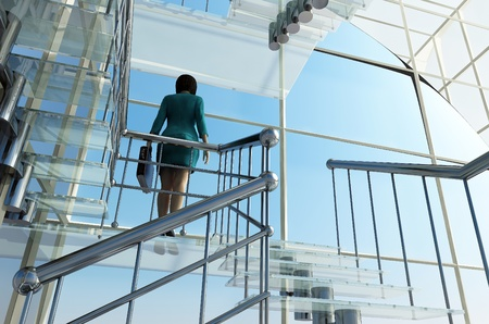 rise to the top: Business woman rises on the glass stairs. Stock Photo