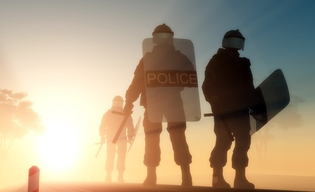 police uniform: A group of policemen with guns in the sun.