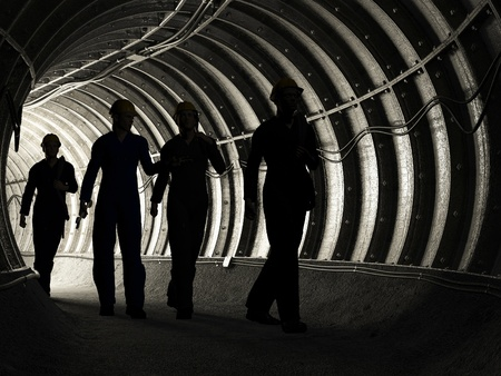 COAL MINER: Silhouette of workers in mine Stock Photo