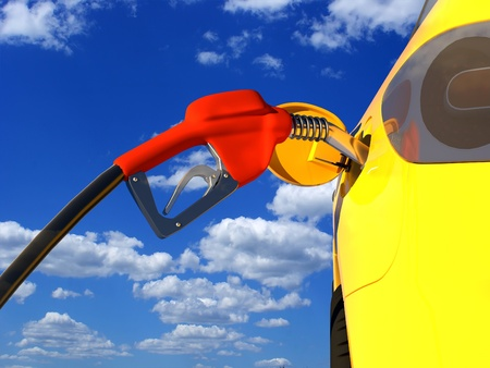 fueled: Car fueled by a blue sky background. Stock Photo