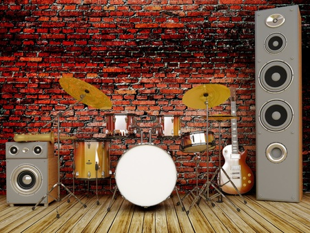 habitacion desordenada: Instrumentos musicales en una pared de ladrillo.