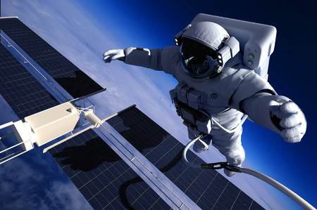 Astronaut in space around the solar battarei.Elemen ts of this image furnished by NASA photo