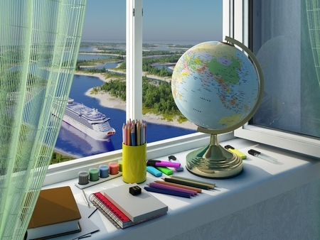 Globe, pencils and books on the window. photo